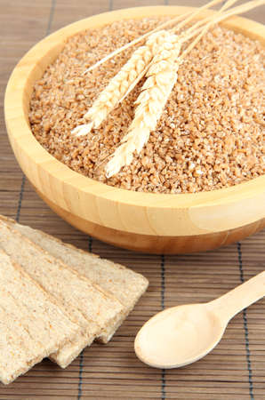 Wooden bowl full of wheat bran Stock Photo - 17052432