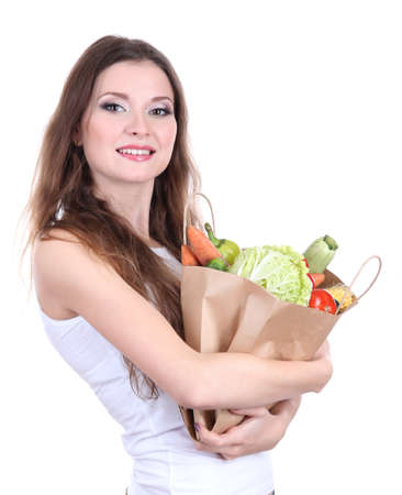 Woman holding a grocery bag full of fresh vegetables isolated on white Stock Photo - 17282203