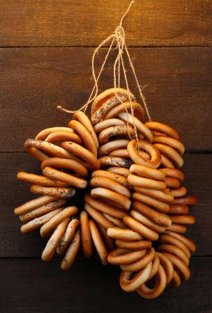 boublik: tasty bagels on rope, on wooden background