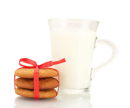 Ginger cookies and milk in glass isolated on white photo