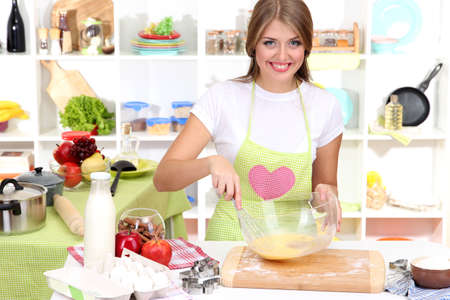 A young girl in kitchen during cooking biscuits Stock Photo - 17282614