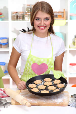 A young girl in kitchen during cooking biscuits Stock Photo - 17282681