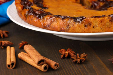 Tasty pie on plate with cinnamon isolated on white Stock Photo - 17052430