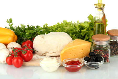Ingredients for pizza isolated on white photo
