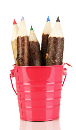 Colorful wooden pencils in pink purple green pail isolated on white photo