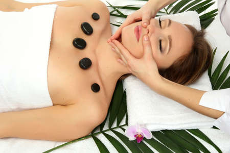 Portrait of beautiful woman with spa stones taking head massage Stock Photo - 17282481