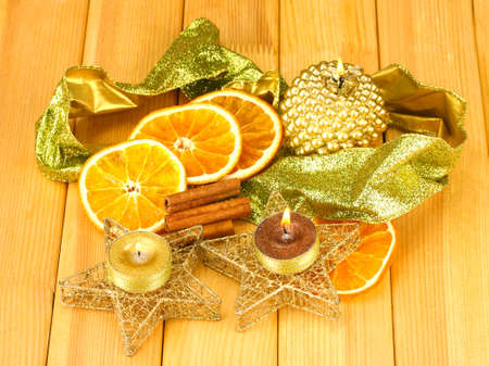 Christmas composition  with candles and decorations on wooden background photo