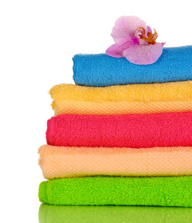 Stack of towels with fragrant flower isolated on white Stock Photo - 17053102
