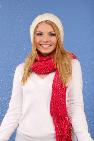 Young beautiful woman with snow on blue background Stock Photo - 17281549
