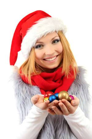 Attractive young woman holding Christmas balls isolated on white photo