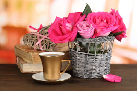 Beautiful pink roses in vase on wooden table on room background Stock Photo - 17053155