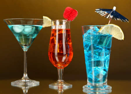 darck: Alcoholic cocktails with ice on darck orange background