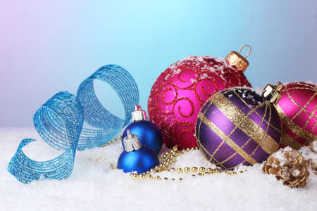 beautiful Christmas balls and cones on snow on bright background Stock Photo - 17053176