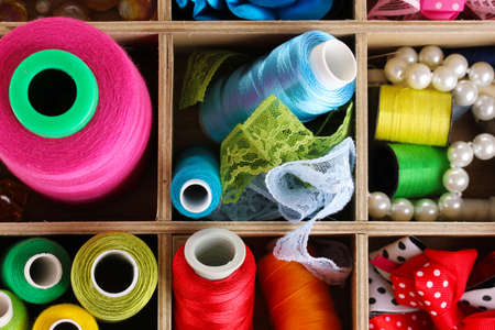 a frill: thread and material for handicrafts in box close-up Stock Photo