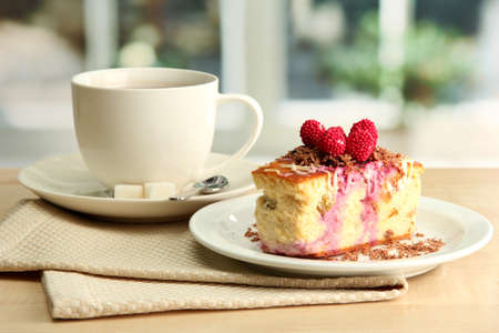 sweet cake with cup of tea on wooden table Stock Photo - 17053157