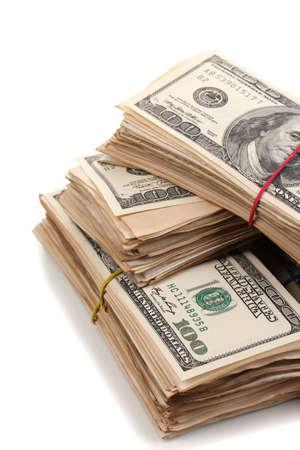 cash money: Las pilas de billetes de cien dólares de cerca aislados en blanco Foto de archivo