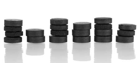 activated: activated carbon in tablets isolated on white Stock Photo
