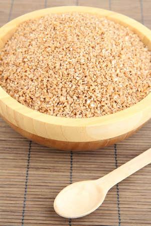 Wooden bowl full of wheat bran Stock Photo - 17053220