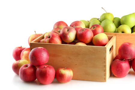 juicy apples in wooden crates, isolated on white photo