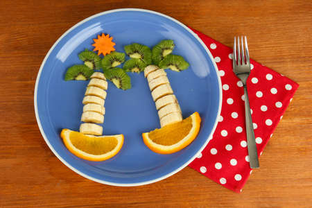 fun food for kids on wooden background photo