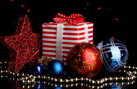 New Year composition of New Year's decor and gifts on Christmas lights background photo
