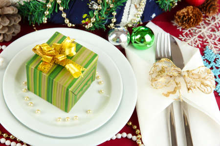 Small Christmas gift on plate on serving Christmas table background close-up Stock Photo - 17064129