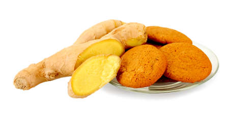 Ginger cookies with fresh ginger root isolated on white photo
