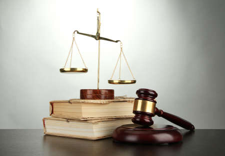Golden scales of justice, gavel and books on grey background Stock Photo - 17063867