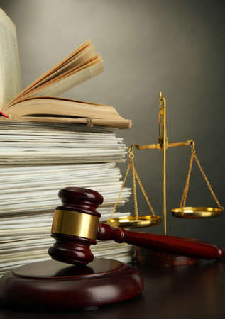 legal court: Golden scales of justice, gavel and books on grey background Stock Photo
