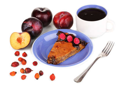 Tasty pie on blue plate with plums isolated on white Stock Photo - 17063929