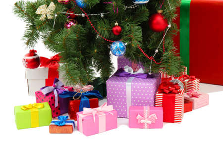 Decorated Christmas tree with gifts isolated on white Stock Photo - 17064298