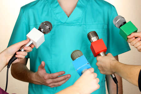press conference: Conference meeting microphones and doctor Stock Photo