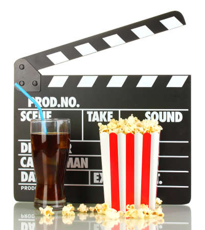 Movie clapperboard, cola and popcorn isolated on white photo