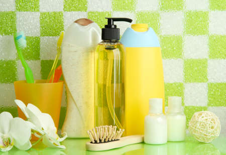Bath accessories on shelf in bathroom on green tile wall background Stock Photo - 17063885