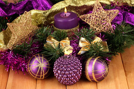 christmas composition with candles and decorations in purple and gold colors on wooden background stock photo - Purple And Gold Christmas Decorations