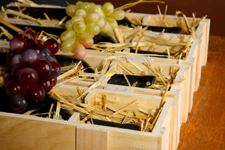 bordeau: Wooden case with wine bottles close up