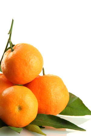 Ripe sweet tangerines with leaves, isolated on white photo