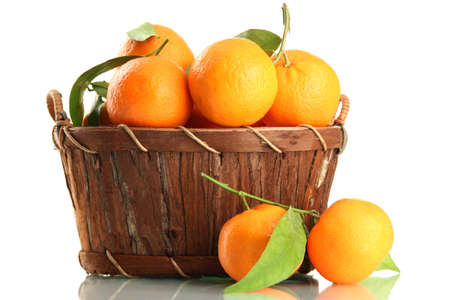Ripe sweet tangerine with leaves in basket, isolated on white Stock Photo - 17063903