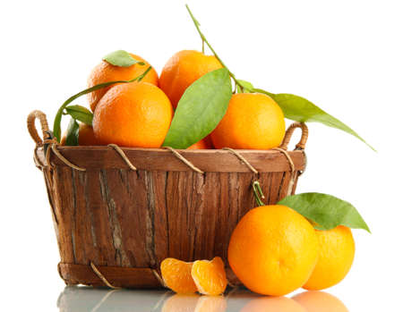 Ripe sweet tangerine with leaves in basket, isolated on white Stock Photo - 17063937