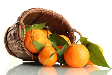 Ripe sweet tangerine with leaves in basket, isolated on white Stock Photo - 17063923
