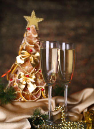beautiful christmas tree and  glasses of champagne on  shine grey background photo