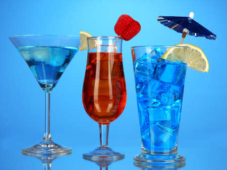 Alcoholic cocktails with ice on blue background Stock Photo - 17063945