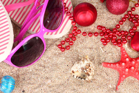 Christmas balls,seashells andh beach accessories on sand, close-up Stock Photo - 17064303
