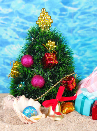 Christmas tree on sand in beach photo