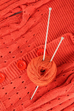 Orange sweater and a ball of wool close-up Stock Photo - 17119389