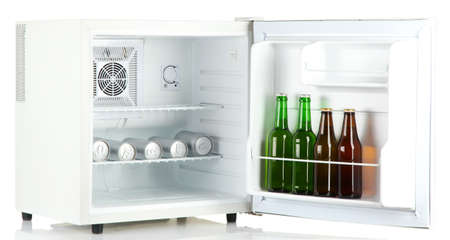 mini fridge full of bottles and cans of beer isolated on white photo