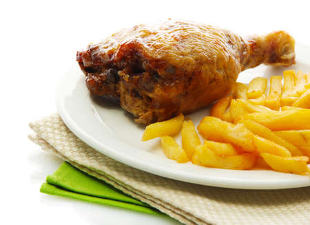 Roast chicken with french fries on plate, isolated on white photo