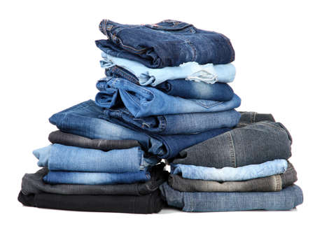 bluejeans: Many jeans stacked in a piles isolated on white