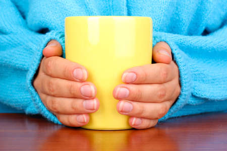 hands holding mug of hot drink close-up Stock Photo - 17117336