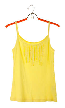 woman's yellow top on a hanger isolated on white photo